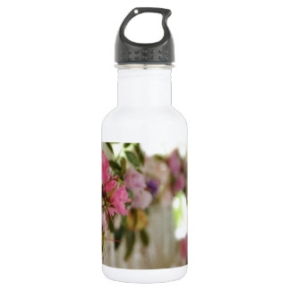 Glass flower vases with spring flowers water bottle