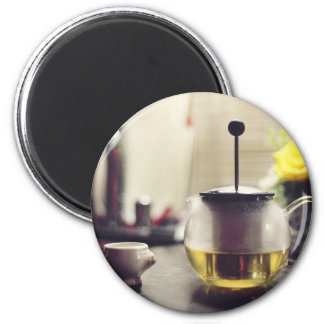 Glass kettle and a porcelain cup magnet
