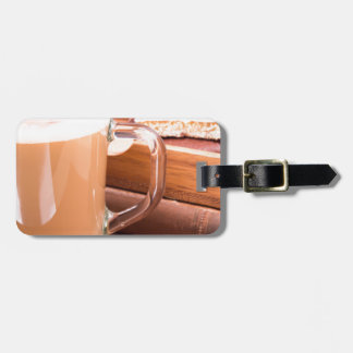 Glass mug with hot chocolate and biscuits bag tag