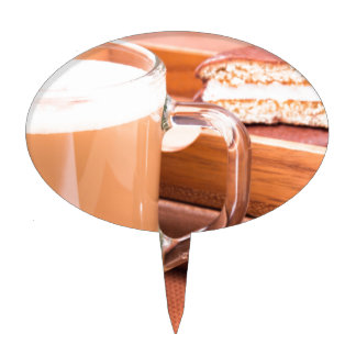 Glass mug with hot chocolate and biscuits cake topper