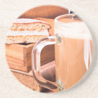 Glass mug with hot chocolate on a table drink coaster