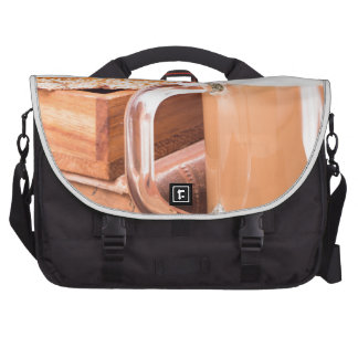 Glass mug with hot chocolate on a table laptop bags