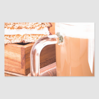 Glass mug with hot chocolate on a table rectangular sticker
