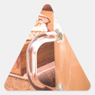Glass mug with hot chocolate on a table triangle sticker