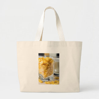 Glass of dry cereal and a glass of milk large tote bag
