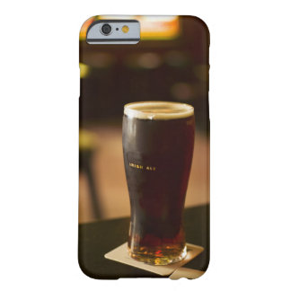 Glass of Irish ale in pub Barely There iPhone 6 Case