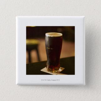 Glass of Irish ale in pub Button