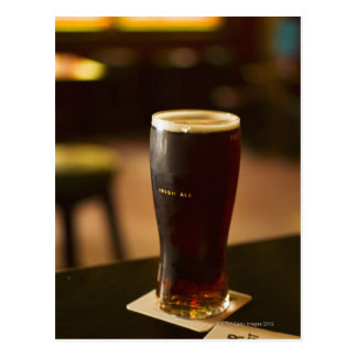 Glass of Irish ale in pub Postcard