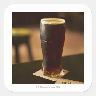Glass of Irish ale in pub Square Sticker