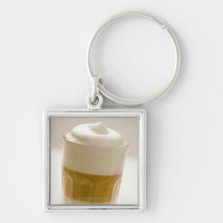 Glass of latte macchiato, close up key chains