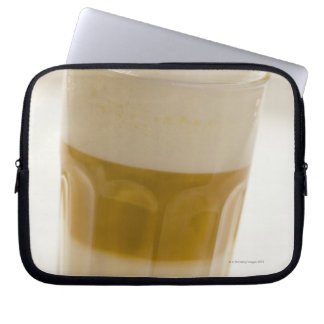 Glass of latte macchiato, close up laptop computer sleeves