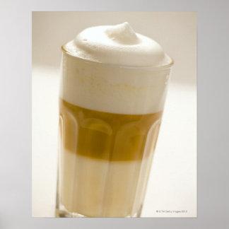 Glass of latte macchiato, close up poster