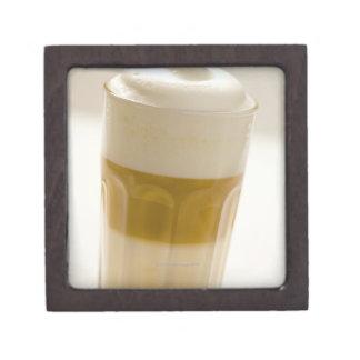 Glass of latte macchiato, close up premium gift box