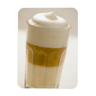 Glass of latte macchiato, close up rectangular photo magnet