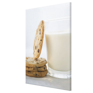 Glass of milk and cookies, close-up canvas print