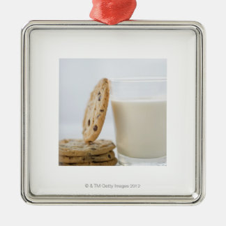 Glass of milk and cookies, close-up metal ornament