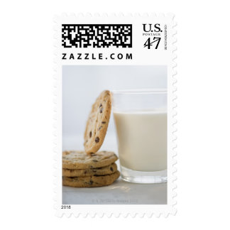 Glass of milk and cookies, close-up postage stamp