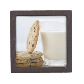 Glass of milk and cookies, close-up premium gift boxes