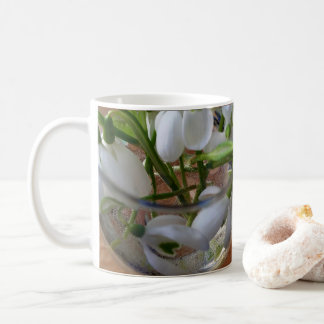 glass of snowdrops coffee mug