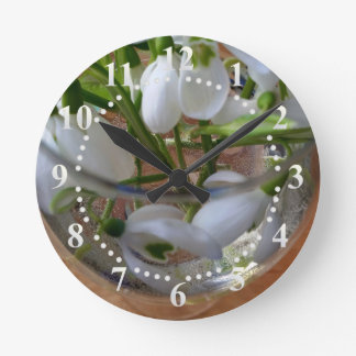 glass of snowdrops round clock