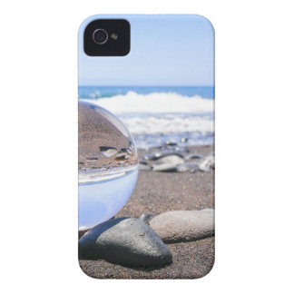 Glass sphere on stones at beach and coast iPhone 4 cover