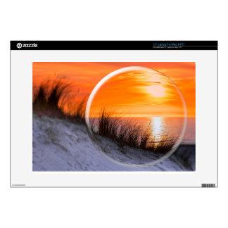 "Glass sphere reflecting orange sunset 15"" laptop decals"