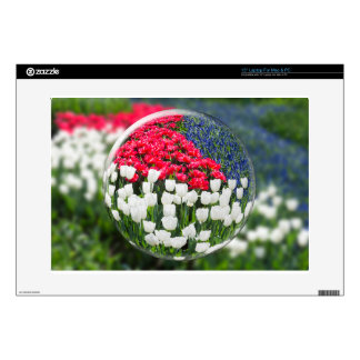 """Glass sphere reflecting red white tulips and blue skin for 15"""" laptop"""