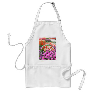 Glass sphere with various tulips in flowers field. adult apron