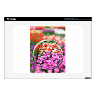 Glass sphere with various tulips in flowers field. decal for laptop