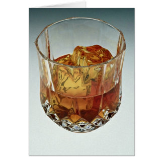 Glass tumbler filled with scotch and ice cubes card