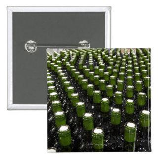 Glass wine bottles in a wine bottling factory. button