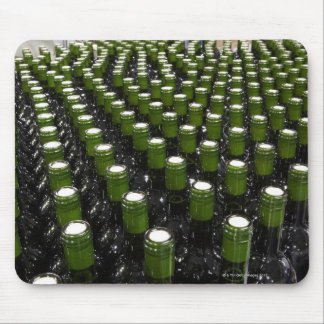 Glass wine bottles in a wine bottling factory. mouse pad