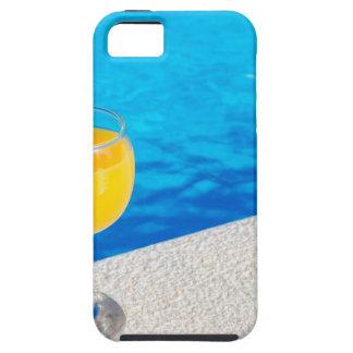 Glass with orange juice on edge of swimming pool iPhone SE/5/5s case