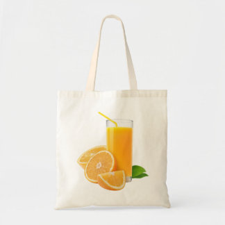 Glass with orange juice tote bag