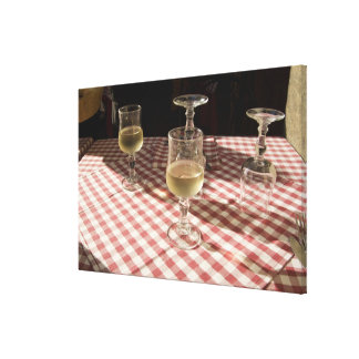 Glasses for water and wine on outdoor red canvas print