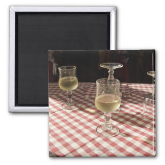 Glasses for water and wine on outdoor red magnet