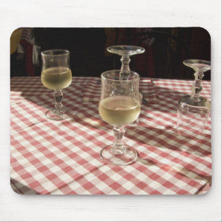 Glasses for water and wine on outdoor red mouse pad