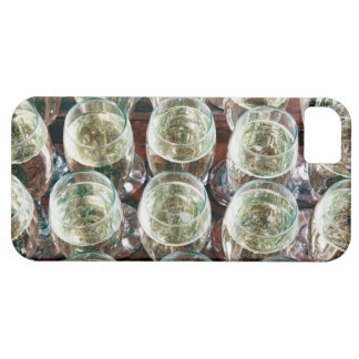 Glasses of Champagne on a table at a celebration iPhone 5 Covers