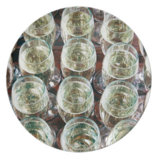 Glasses of Champagne on a table at a celebration Plate