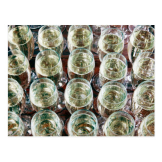Glasses of Champagne on a table at a celebration Postcard