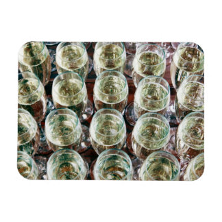 Glasses of Champagne on a table at a celebration Rectangular Photo Magnet