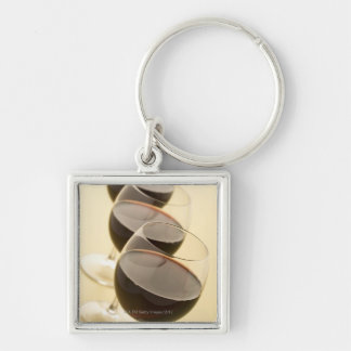 Glasses of red wine keychain