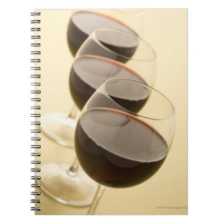 Glasses of red wine spiral note book