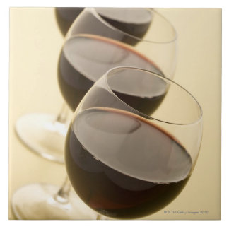 Glasses of red wine large square tile