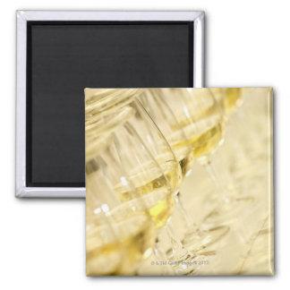 Glasses of white wine for wine tasting, close up magnet