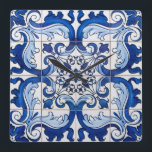 """Glazed Tiles Portuguese Azulejo Style Square Wall Clock<br><div class=""""desc"""">Glazed Tiles Portuguese Azulejo Style floral pattern in blue and white transported to the surface of a modern Wall Clock, preserving its history and tradition. Azulejo is a form of Portuguese or Spanish painted, tin-glazed, ceramic tilework. It has become a typical aspect of Portuguese culture. Portugal imported azulejo tiles from...</div>"""