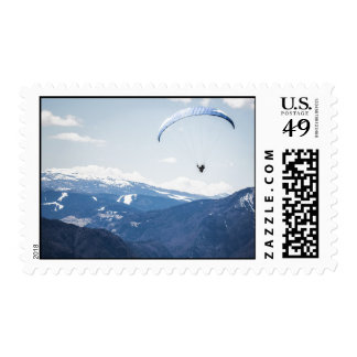 Gliding over chain of mountains postage