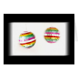 Glitterballs que hace girar el fondo negro tarjeta de felicitación