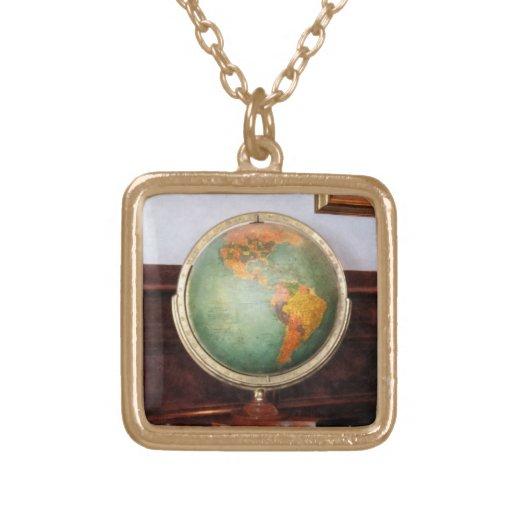 Globe on Piano Custom Jewelry