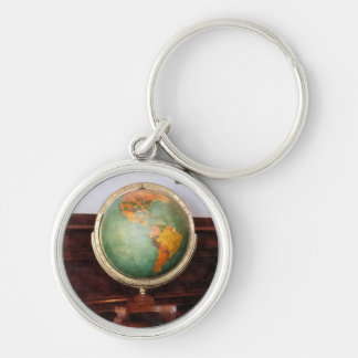 Globe on Piano Silver-Colored Round Keychain